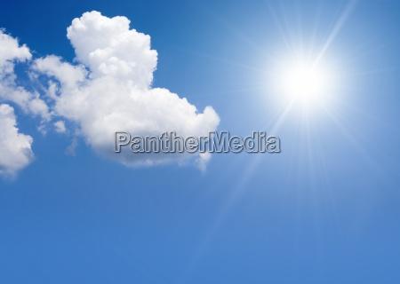 kumuluswolken und sonne