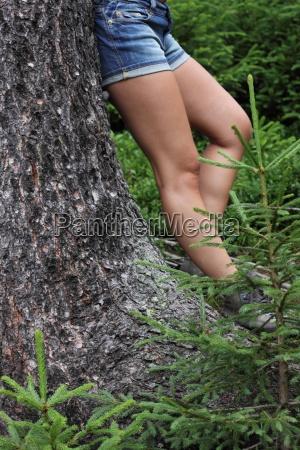 woman legs tree trunk hike go