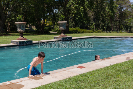 boy girl pool summer