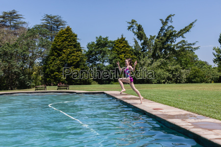 girl jumping pool