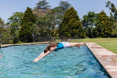 girl diving swimming pool