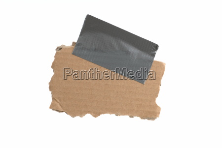 isolated old cardboard with adhesive tape