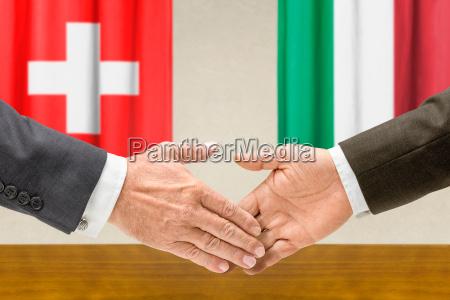 representatives of switzerland and italy reach