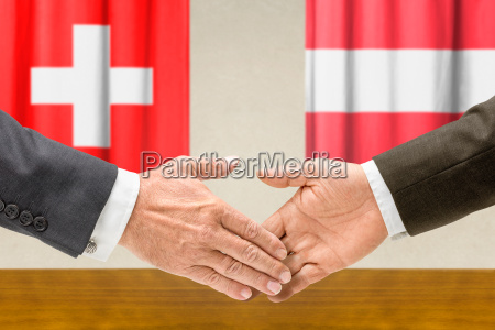 representatives of switzerland and austria reach