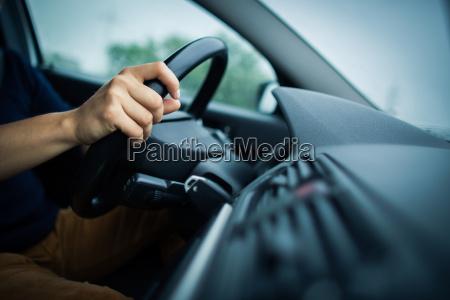 driving a car at night man