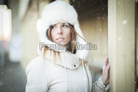 winter girl in warm clothes snowy