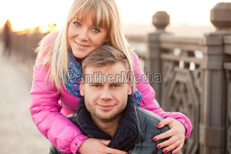 woman is hugging her boyfriend in