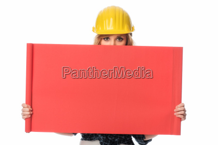 construction worker holding up billboard