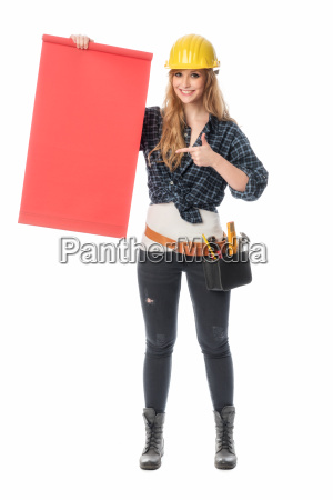 female craftsman holding a red signboard