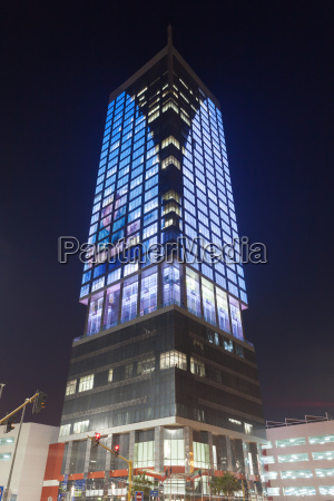 wataniya telecom hq skyscraper illuminated at