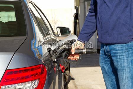 man when refueling