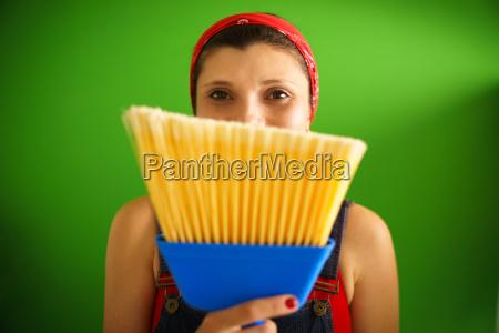 portrait of happy woman doing chores