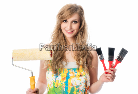 woman with various paintbrushes