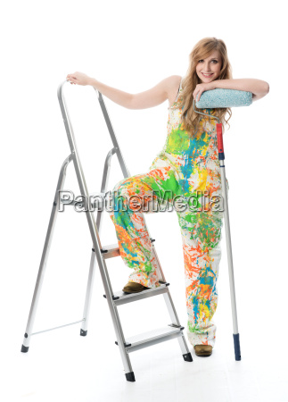 woman with paint roller standing on