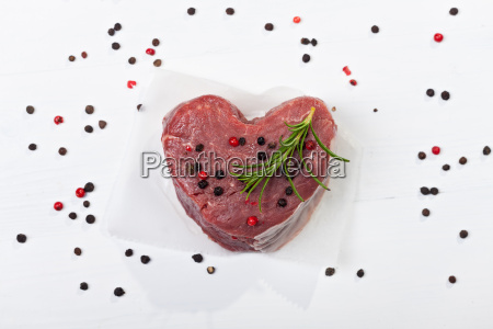 raw beef fillet on wood