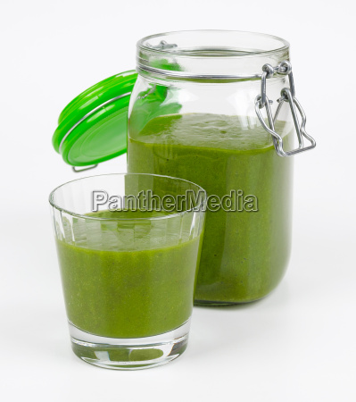 green smoothie in a glass and
