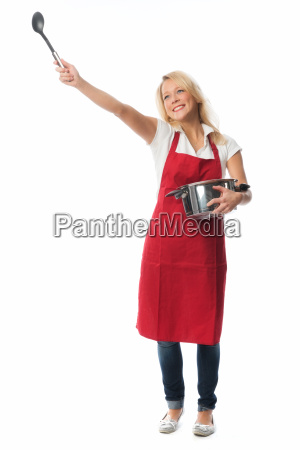cheerful woman with apron holding a