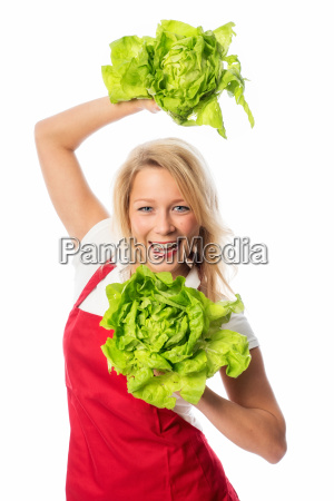 woman with apron presenting lettuce