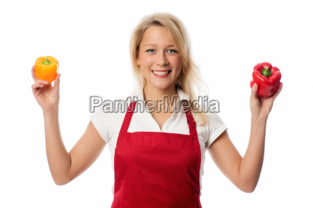 housewife with apron presenting peppers