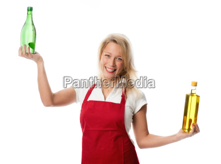 woman with apron presenting a bottle