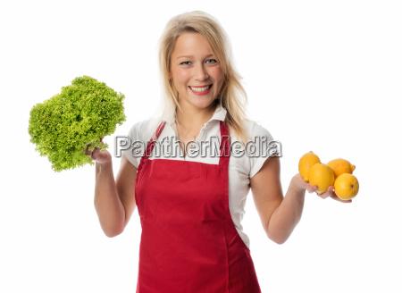 housewife holding salad and lemon