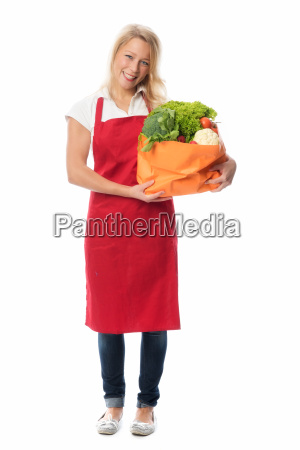 blonde housewife with apron presenting a