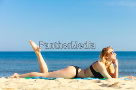 summer vacation girl in bikini sunbathing