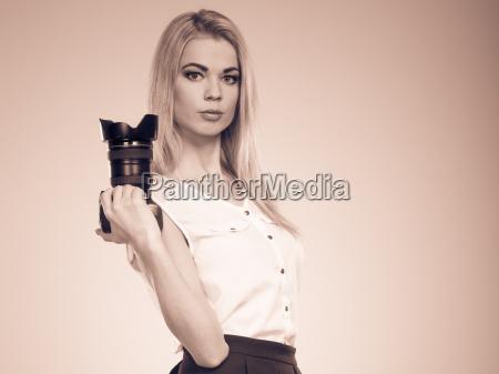 girl photographer shooting images