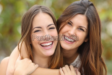 two women friends laughing with a