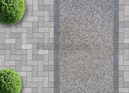 pflastersteine mit kiesweg und buchsbaeumen von