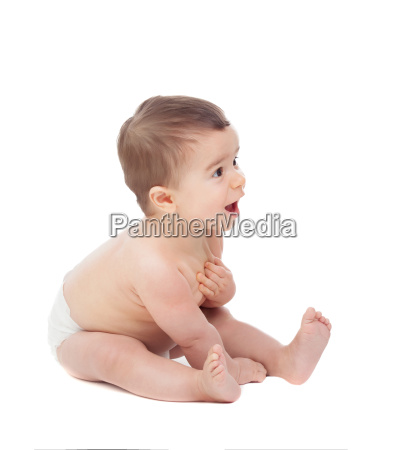 surprised six month baby in diaper