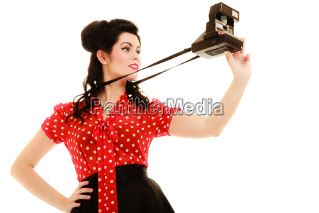 retro pinup girl taking photo with