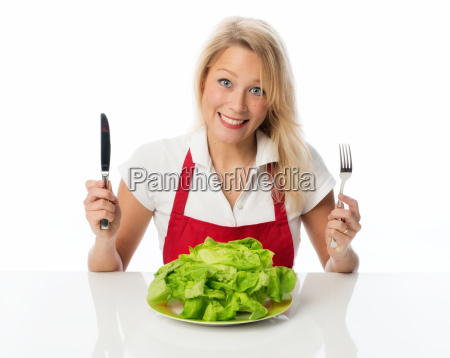 blond woman holding dinner set and