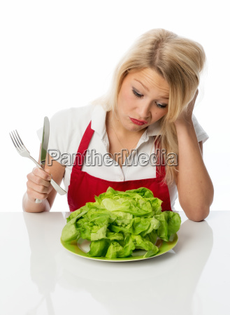 woman with lettuce pulls a pout