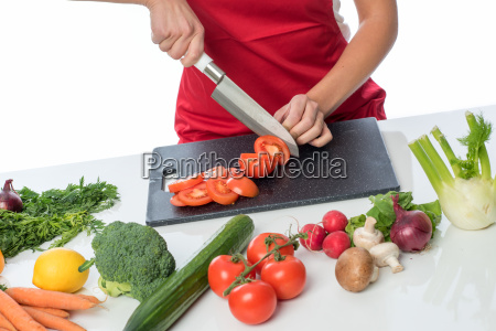 blonde woman crushed tomatoes and prepares