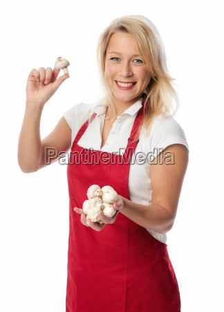 housewife in apron holding a handful