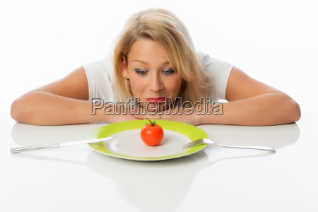 blonde woman staring at a plate
