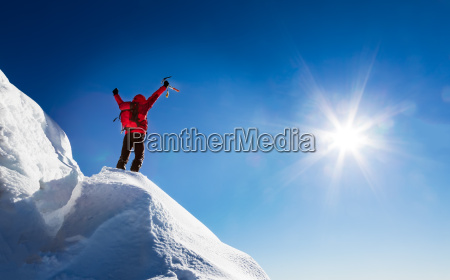 mountaineer celebrates the conquest of the