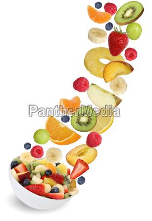 flying fruit salad with fruits like
