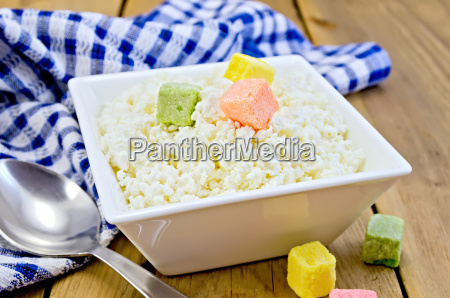curd with colored sugar and spoon