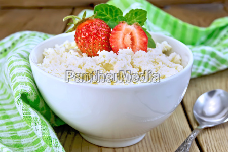 curd with strawberries in white bowl