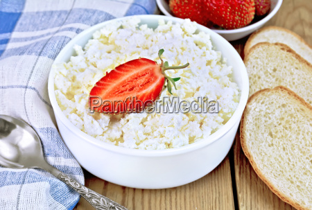 curd with strawberries in bowl and