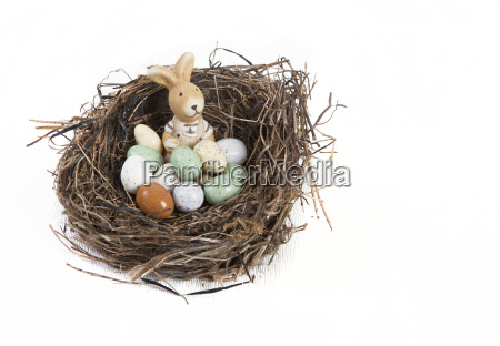 easter nest with eggs and hare