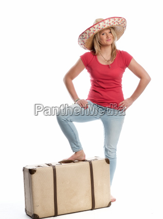 woman with sombrero stands with her