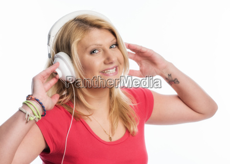 blonde woman portrait wearing headphones