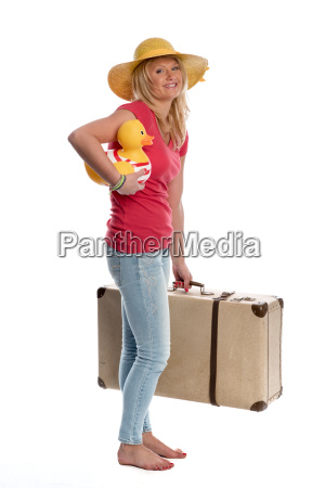 young woman with summer hat carries