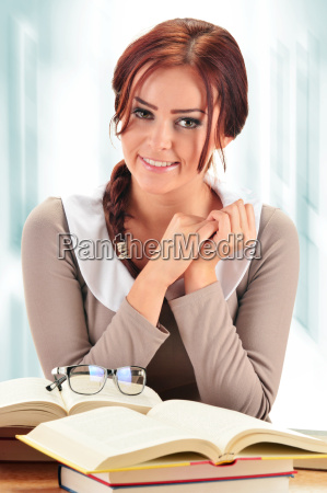 young woman reading a book female