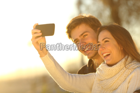 couple taking selfie photo with a