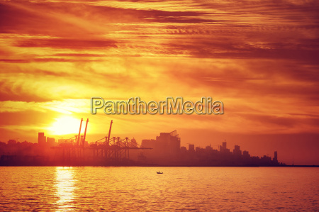 silhouette of city in sunset light