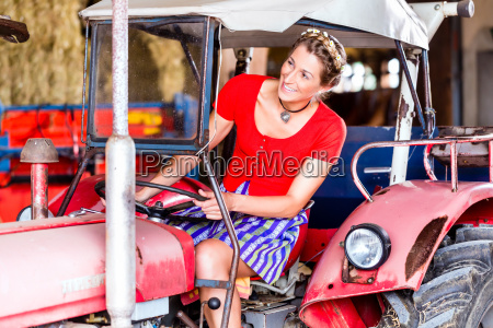 bavarian woman with dirndl is riding